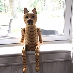 Pier 1 wooden cat with movable arms and legs.